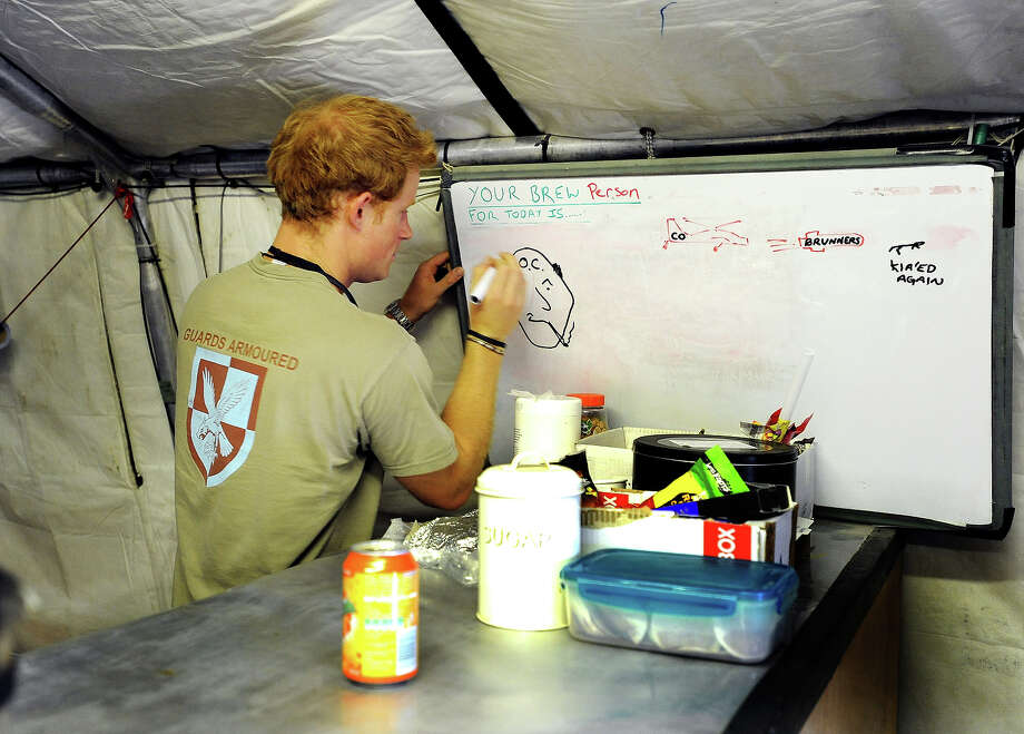 Prince Harry drawing the shift brew person (who makes the tea all day) during his 12 hour VHR (very high ready-ness) shift at the British controlled flight-line at Camp Bastion on November 3, 2012 in Afghanistan. Prince Harry has served as an Apache Helicopter Pilot/Gunner with 662 Sqd Army Air Corps, from September 2012 for four months until January 2013. Photo: WPA Pool, Getty Images / 2013 Getty Images