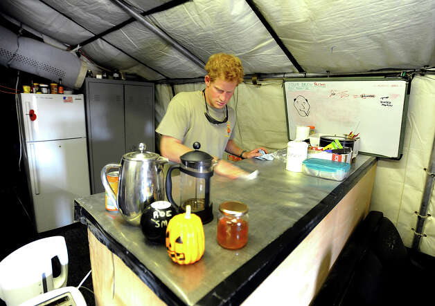Prince Harry cleans the Kitchen work-top during his 12 hour VHR (very high ready-ness) shift at the British controlled flight-line at Camp Bastion on October 31, 2012 in Afghanistan. Prince Harry has served as an Apache Helicopter Pilot/Gunner with 662 Sqd Army Air Corps, from September 2012 for four months until January 2013. Photo: WPA Pool, Getty Images / 2013 Getty Images