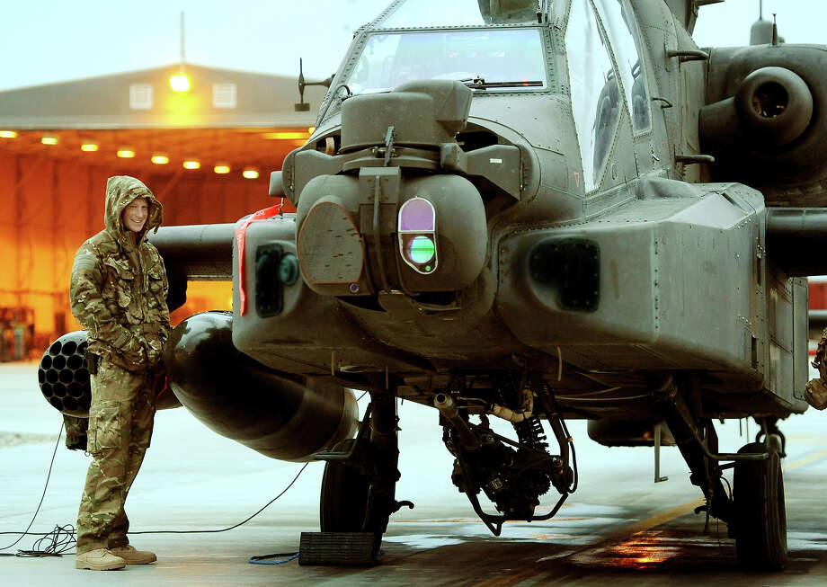 (Some parts of this picture have been digitally changed for security reasons) Prince Harry, makes his early morning pre-flight checks at the British controlled flight-line at Camp Bastion on December 12, 2012 in Afghanistan. Prince Harry has served as an Apache Helicopter Pilot/Gunner with 662 Sqd Army Air Corps, from September 2012 for four months until January 2013. Photo: WPA Pool, Getty Images / 2013 Getty Images