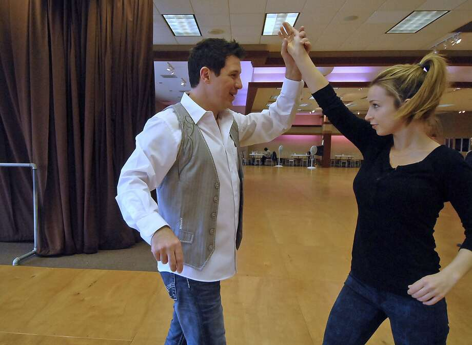 Damon D'Amico shows Alex Whitney, 22, how to do the Texas two-step at D'Amico Dance, 1115 Westheimer. Her lessons were a Christmas gift from her grandmother. Photo:  Tony Bullard 2012, Freelance Photographer / © Tony Bullard & the Houston Chronicle