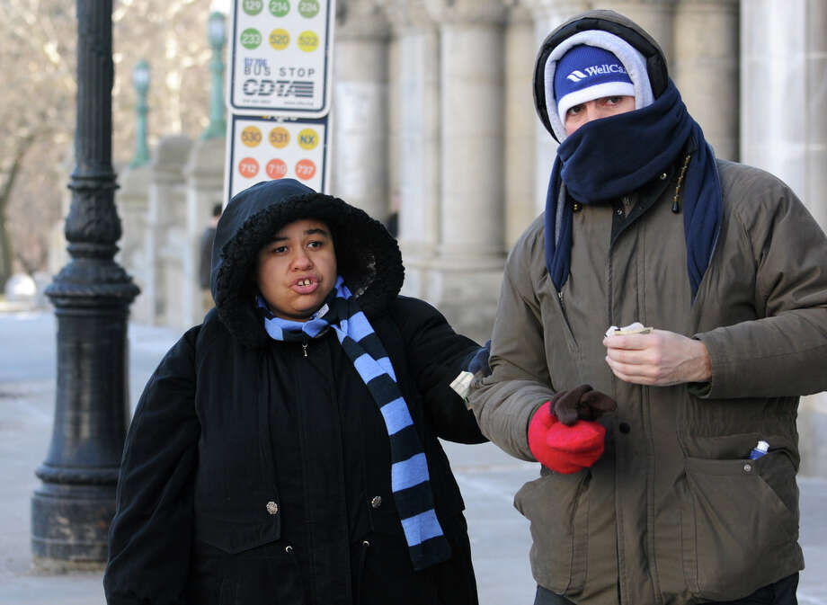 Melissa Rogers and her husband, Jimmy Rogers, of Albany wait for a bus outside the Capitol on a bitterly cold day on Tuesday Jan. 22, 2013 in Albany, N.Y.  (Lori Van Buren / Times Union) Photo: Lori Van Buren