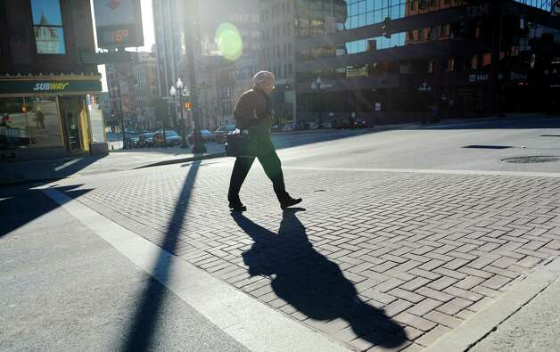 The sun shines down on a very cold morning along State Street on Tuesday, Jan. 22, 2013 in Albany, NY.  (Paul Buckowski / Times Union) Photo: Paul Buckowski / 00020854A
