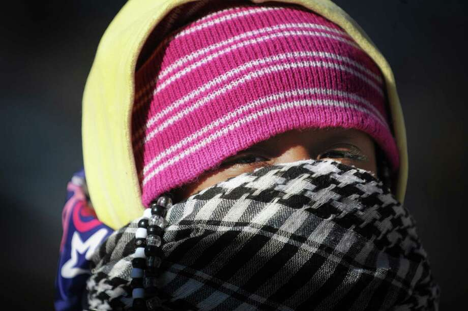 Niemah Johnson, 3, of Albany is bundled up against the cold on North Pearl St. on Tuesday, Jan. 22, 2013 in Albany, NY.  (Paul Buckowski / Times Union) Photo: Paul Buckowski  / 00020854A