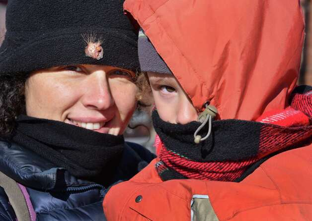 Kati Illouz and son Daniel Korevaar, 3, of Schenectady brave the cold as they make their way home from story time at the Schenectady Library Tuesday Jan 22, 2013. (John Carl D'Annibale / Times Union) Photo: John Carl D'Annibale / 00020854A