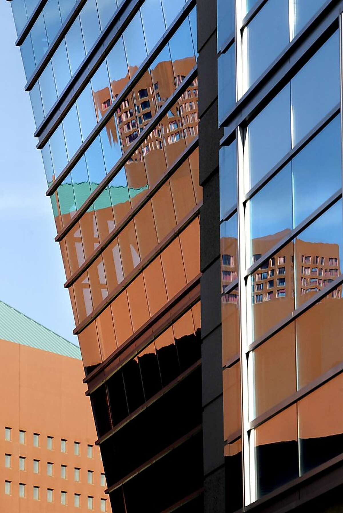 The William J. Rutter Center is reflected in the windows of Genentech Hall on Friday Jan. 18, 2013, in San Francisco, Calif. The Mission Bay campus of UCSF is celebrating it's tenth anniversary since the first scientists moved into Genentech Hall.
