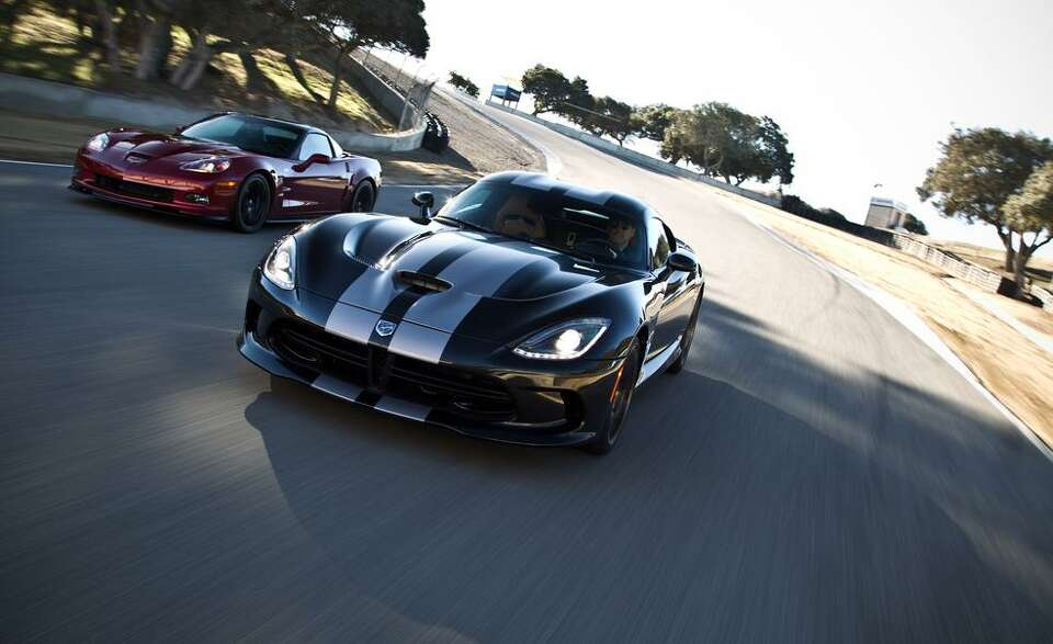 Car & Driver road tests the 2013 SRT Viper GTS vs. 2013 Chevrolet Corvette ZR1 at Laguna Seca.