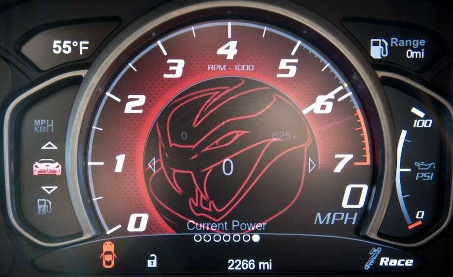 Car & Driver road tests the 2013 SRT Viper GTS vs. 2013 Chevrolet Corvette ZR1 at Laguna Seca. Photo: Charlie Magee