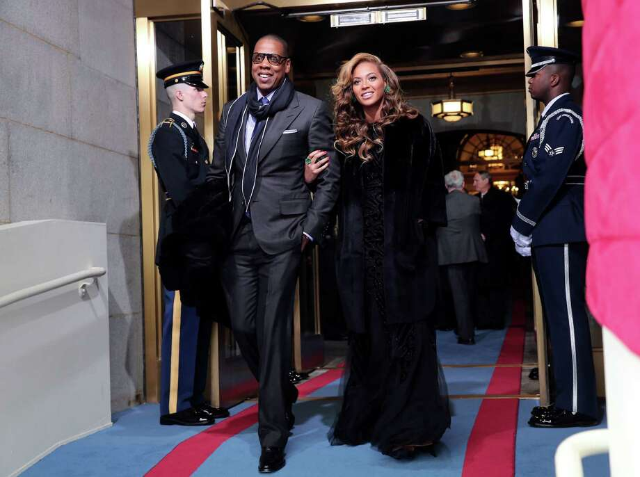 Before rumored lip-syncing, Beyonce arrived with Jay-Z Obama's ceremonial swearing-in ceremony during the 57th Presidential Inauguration. Photo: AP