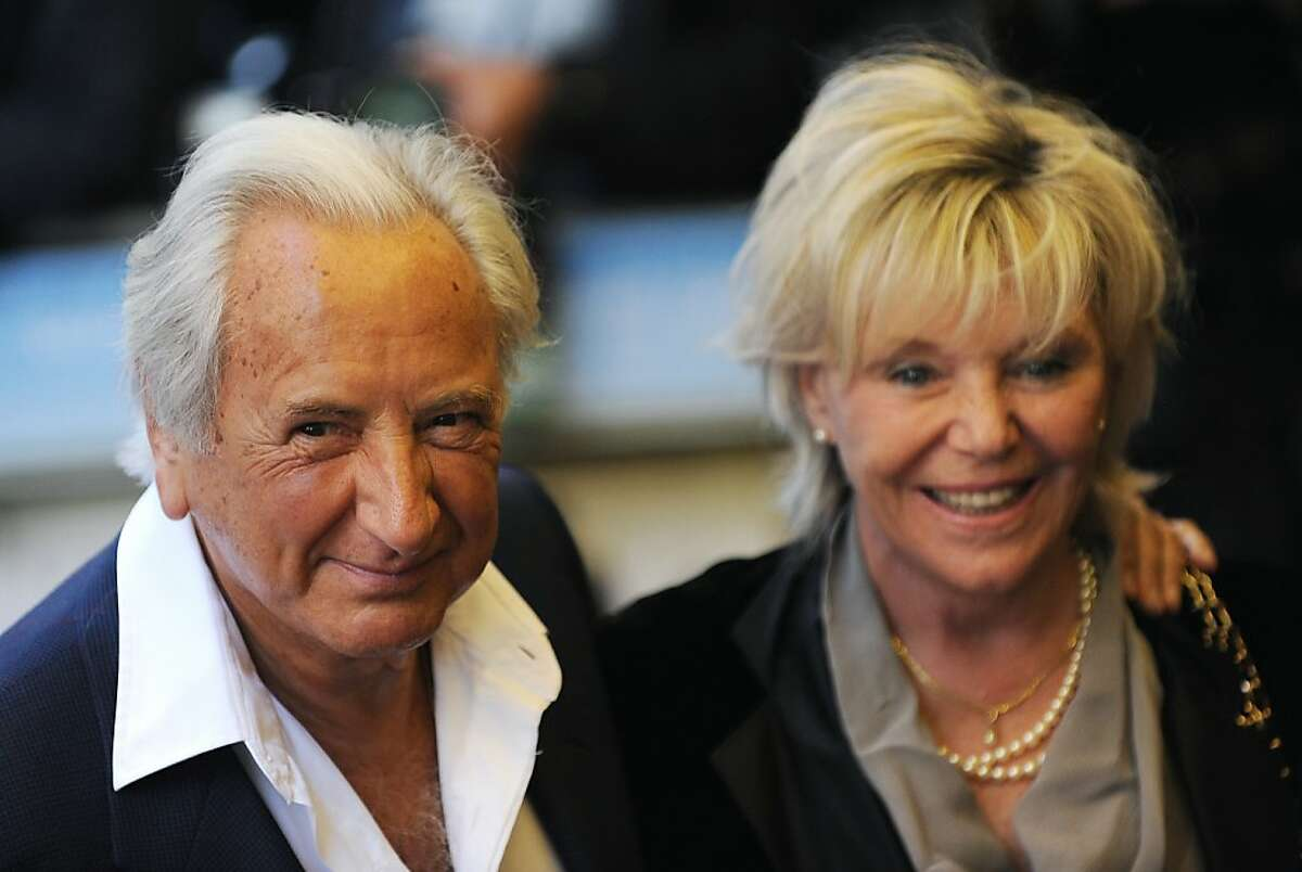 """(FILES) In this file picture taken on April 29, 2009 British film director Michael Winner (L) and his companion Geraldine Lynton-Edwards arrive for the premiere of the film """"Is Anybody There?"""" in London. British film director Michael Winner, who made the violent thriller """"Death Wish"""" and become a restaurant critic in later life, has died at the age of 77, his wife said on January 21, 2013. Winner had been ill for some time and after a spell in hospital last year died at his home in the upscale west London district of Kensington, Geraldine Winner said in a statement. AFP PHOTO/Carl de SouzaCARL DE SOUZA/AFP/Getty Images"""