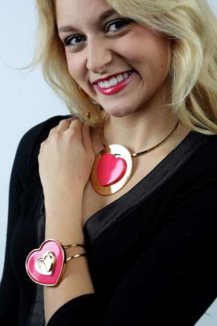 Heart to heart: Courteney Lerch models Betsey Johnson heart pendant choker and matching bracelet, both $51; Betsey Johnson heart drop earrings, $27, all from Dillard's North Star Mall. Photo: Helen L. Montoya, San Antonio Express-News / ©2013 San Antonio Express-News