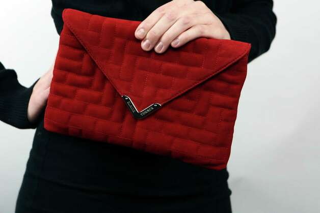 Morgan models a red, soft suede quilted clutch, $135, from Elaine Turner. Photo: Helen L. Montoya, San Antonio Express-News / ©2013 San Antonio Express-News