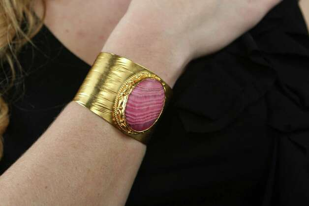 Morgan Pointon models soft pink stone and brushed gold cuff, $275, from Elaine Turner, 5922 Broadway St. Photo: Helen L. Montoya, San Antonio Express-News / ©2013 San Antonio Express-News