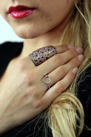 Courteney Lerch models a mini-heart diamond ring by David Yurman, $475, Neiman Marcus, and a cocktail capetian ring in 18k rose gold, diamonds and pink sapphires, $11,000, from Lauren Craft at Sloan Hall. Photo: Helen L. Montoya, San Antonio Express-News / ©2013 San Antonio Express-News