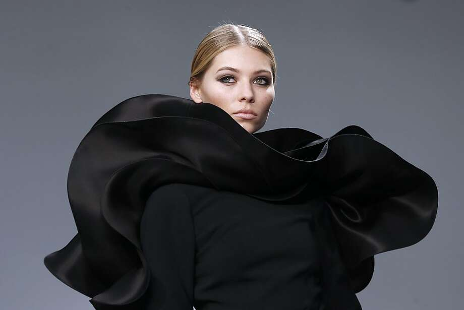Hats off to French designer Stephane Rolland, who's created a Snuggie suitable for the opera. (Haute Couture Spring-Summer 2013 collection shows in Paris.) Photo: Francois Guillot, AFP/Getty Images