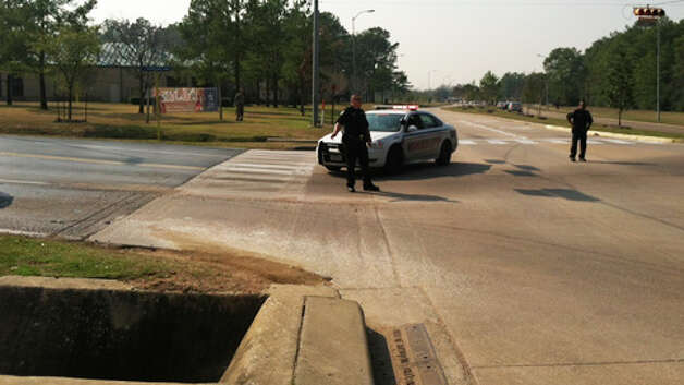 Police block off streets at the scene of the campus shooting. Photo: James Nielsen, Chronicle