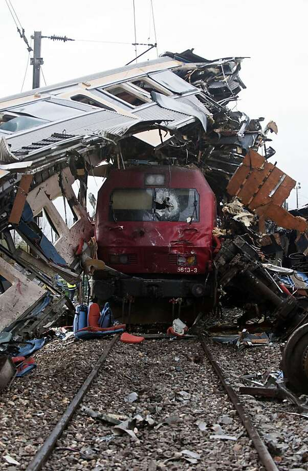 What happens when high-speed rail hits low-speed rail: A local train was waiting to enter a station in Alfarelos, Portugal, when an intercity train rear-ended it at high velocity. Several coaches derailed, but injuries to 21 passengers and crew were mild.  Photo: Miguel Teixeira, Associated Press