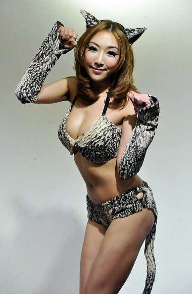 Especially cats: Taiwanese singer Mina Lee, in feline ears and tail, urges people to be kind
