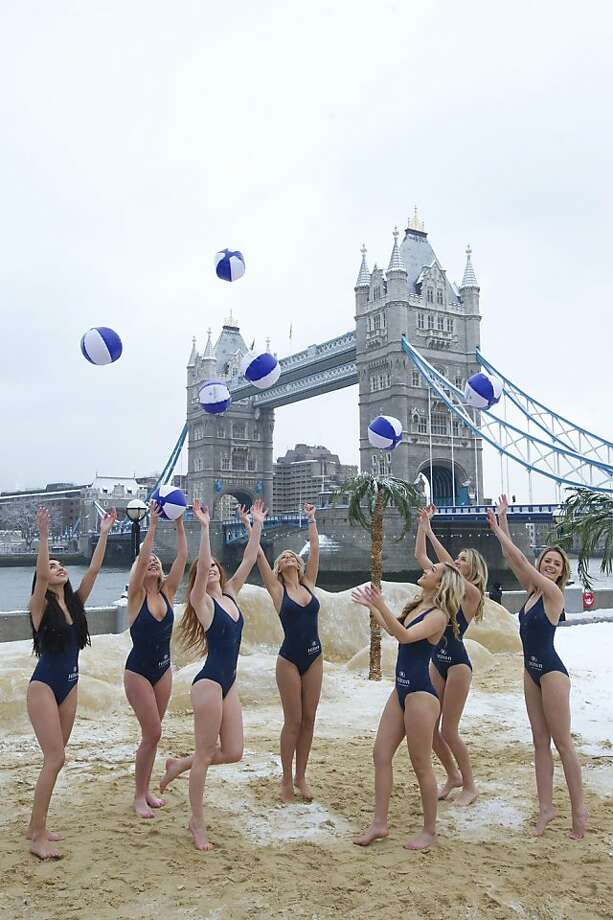 "Stiff upper lip, ladies: In London, snow shut schools, disrupted transit and canceled flights, but it did not prevent models from playing with beach balls at a ""pop-up beach resort"" promotion. Photo: Carl Court, AFP/Getty Images"