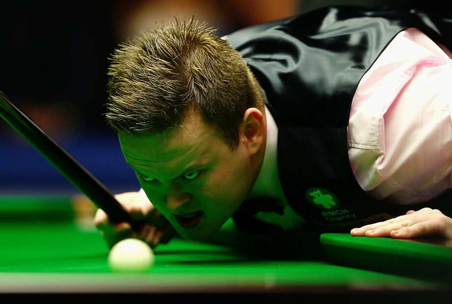 Do not shoot eight ball with this guy for money:Shaun Murphy of England lines up a shot during a pool competition at Alexandra Palace in London. Photo: Paul Gilham, Getty Images