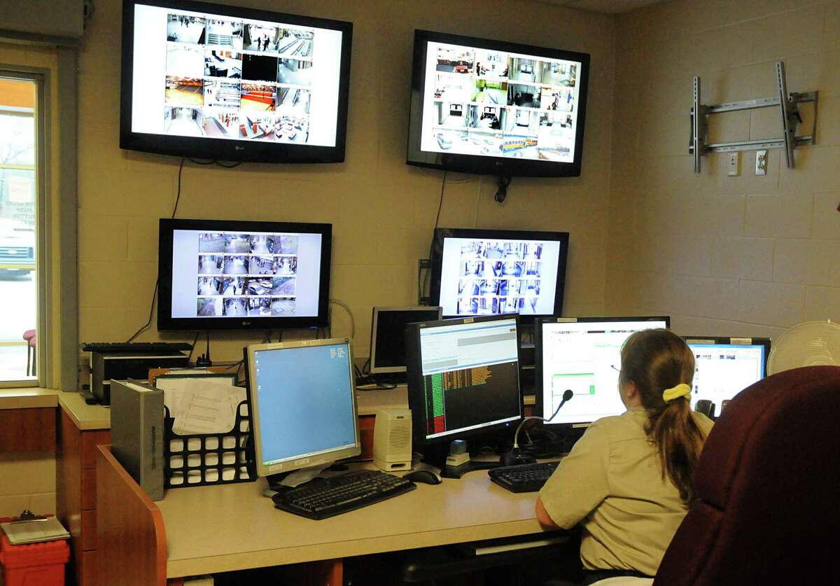 Conroe Independent School District police department telecommunications operator Lisa Dunham uses a high-tech camera system to monitor students and campuses at the department's office in Conroe.