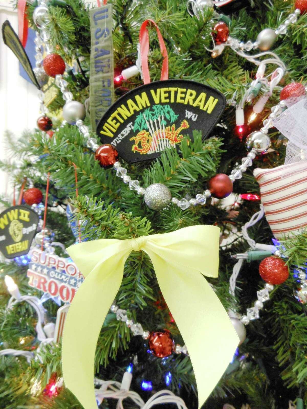 Above the yellow ribbon is a patch that belonged to Vietnam veteran Vincent Wu, a member of Post 3903 who died last year. His wife, JoAnn, is an auxiliary member. Above the yellow ribbon is a patch that belonged to Vietnam veteran Vincent Wu, a member of Post 3903 who died last year. His wife, JoAnn, is an auxiliary member.
