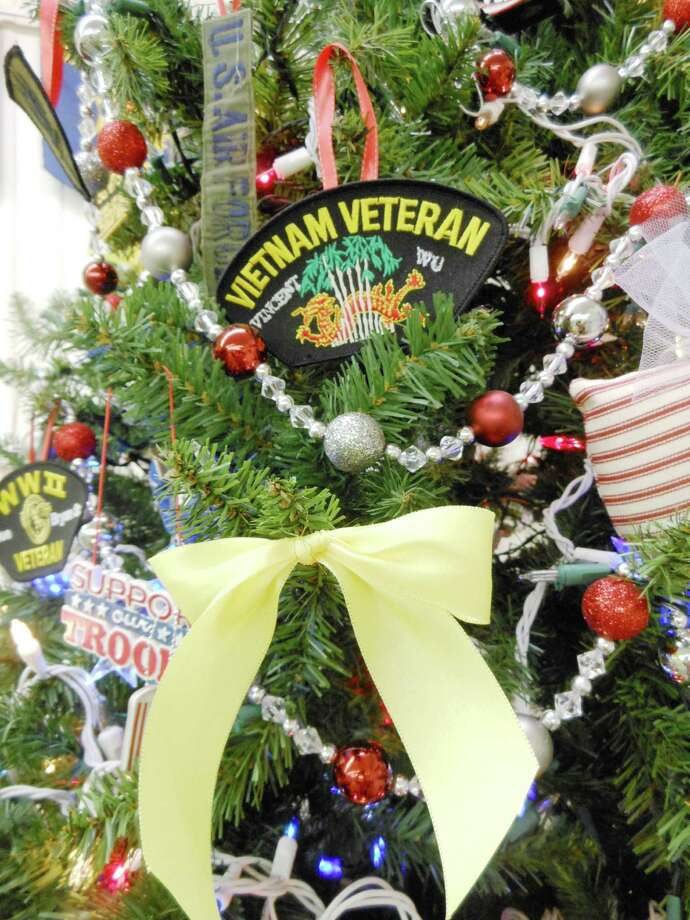 Above the yellow ribbon is a patch that belonged to Vietnam veteran Vincent Wu, a member of Post 3903 who died last year. His wife, JoAnn, is an auxiliary member. Above the yellow ribbon is a patch that belonged to Vietnam veteran Vincent Wu, a member of Post 3903 who died last year. His wife, JoAnn, is an auxiliary member. Photo: B.J. Pollock