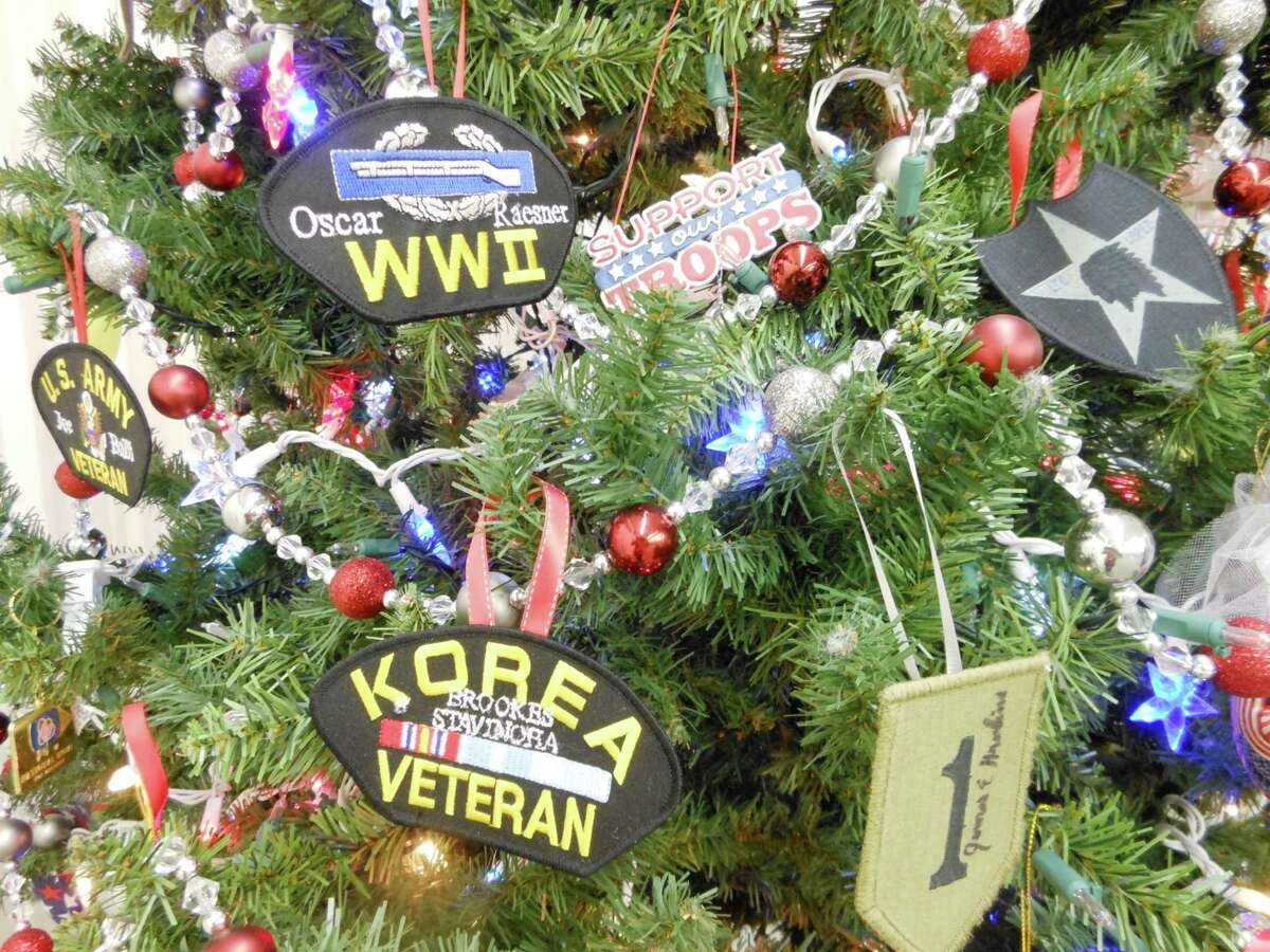 The tree includes patches that belong to Rosenberg VFW Post 3903 members: World War II veteran Oscar Raesner, Korean War veteran Brookes Stavinoha and, at far left, U.S. Army veteran Joe Balli, who served in Vietnam. At right are patches mailed in by family members of other veterans. The tree includes patches that belong to Rosenberg VFW Post 3903 members: World War II veteran Oscar Raesner, Korean War veteran Brookes Stavinoha and, at far left, U.S. Army veteran Joe Balli, who served in Vietnam. At right are patches mailed in by family members of other veterans.