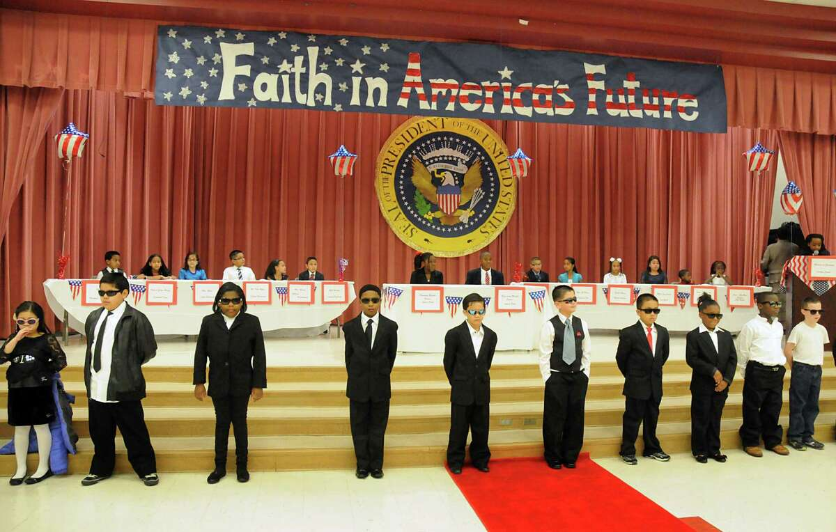 Secret Service agents provide security for the President, his family and staff during Spring ISD's Heritage Elementary School mock inaugural ball, which featured pupils portraying members of the presidential party, as well as those who entertained them.