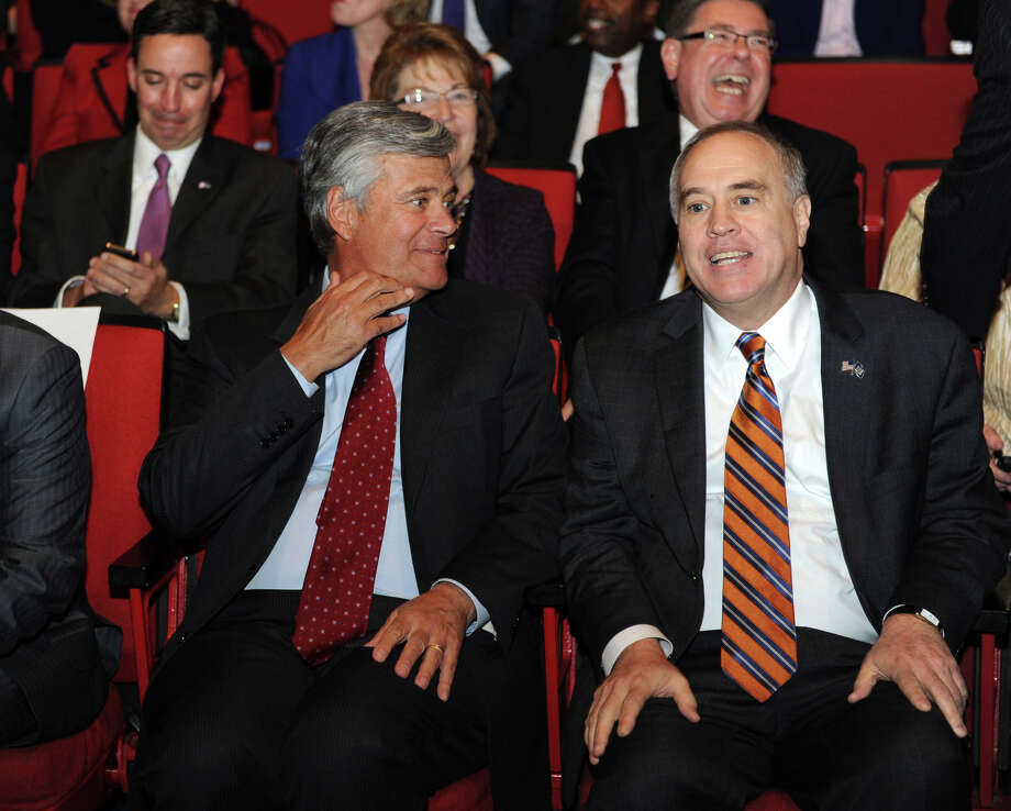 Senator Dean Skelos, left, and Hon. Thomas DiNapoli chat before Governor Andrew Cuomo delivers his budget proposal for fiscal year 2013-14 in the Hart Theater in The Egg on Tuesday Jan. 22, 2013 in Albany, N.Y.  (Lori Van Buren / Times Union) Photo: Lori Van Buren