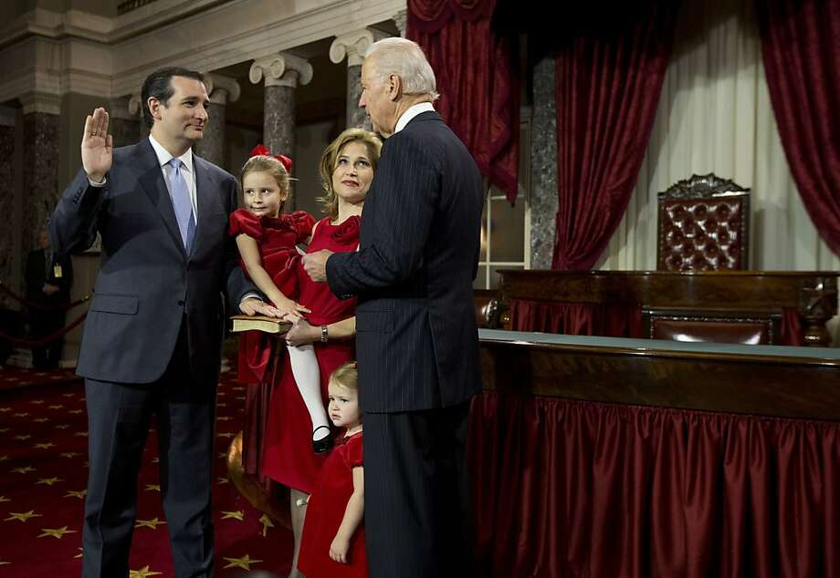 Sen. Ted Cruz, R-Texas, with his family as he's sworn in by Vice President Joe Biden. Photo: Evan Vucci, Associated Press