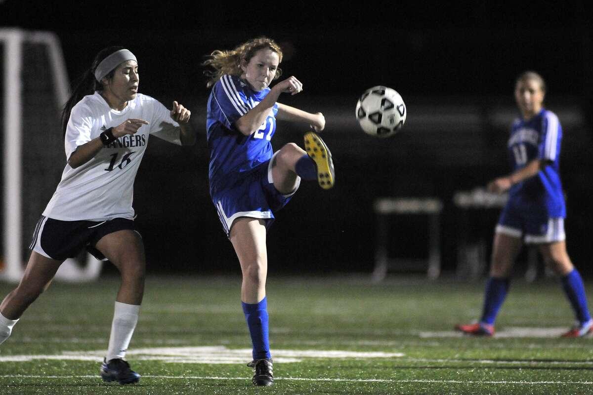Oak Ridge junior midfielder Claire Schuman, center, works the ball against a Baytown Sterling defender. Freelance photo by Jerry Baker
