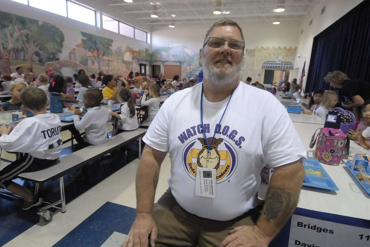 Nottingham Country Elementary Watch D.O.G.S. member Gene Britton volunteers during a Friday lunch.
