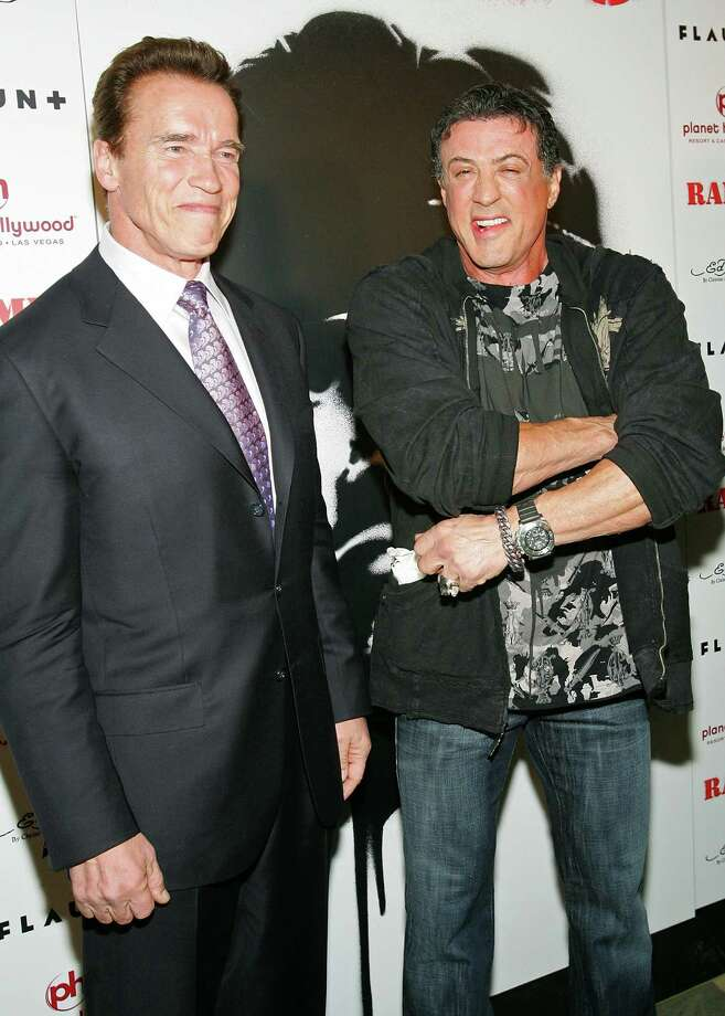 "Arnold Schwarzenegger and Sylvester Stallone, in what we can only assume is an attempt to prove that they are both too old to perform certain action moves, suffered the same leg injury while shooting for their upcoming film, ""The Tomb."" And what was the offending ""action sequence?"" Stallone pulled a calf muscle when jumping off a ladder. Schwarzenegger, learning a lesson from his co-star's pain, decided to warm up before performing the same move and injured the same muscle during the warm-up. ""It would never have happened 20 years ago,"" Schwarzenegger said. ""We were like two idiots standing there. It was pitiful."" Photo: Ethan Miller, Getty Images / Getty Images North America"