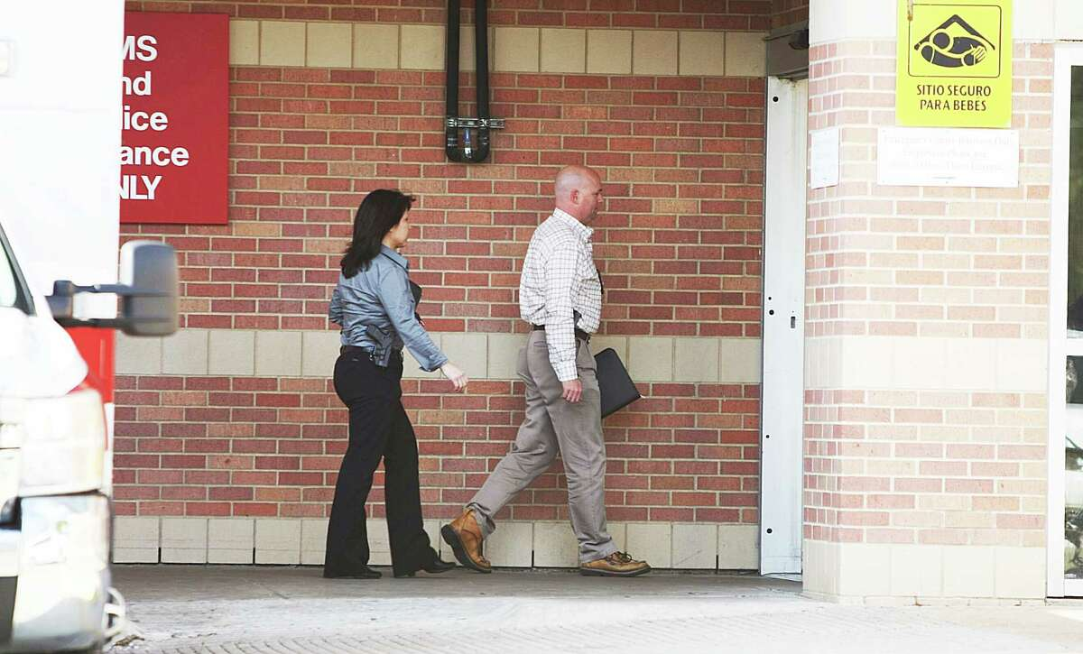 Sherrifs office investigators enter Ben taub hospital trauma center.