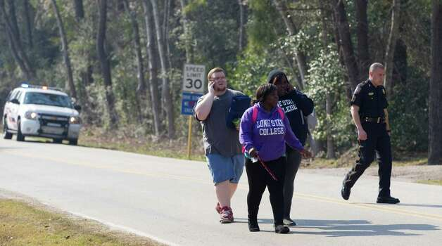 Lone Star College students walk away from the college after they were evacuated from the campus following a shooting at the north Harris County school Tuesday, Jan. 22, 2013, in Houston. Photo: Brett Coomer, Houston Chronicle / © 2013 Houston Chronicle