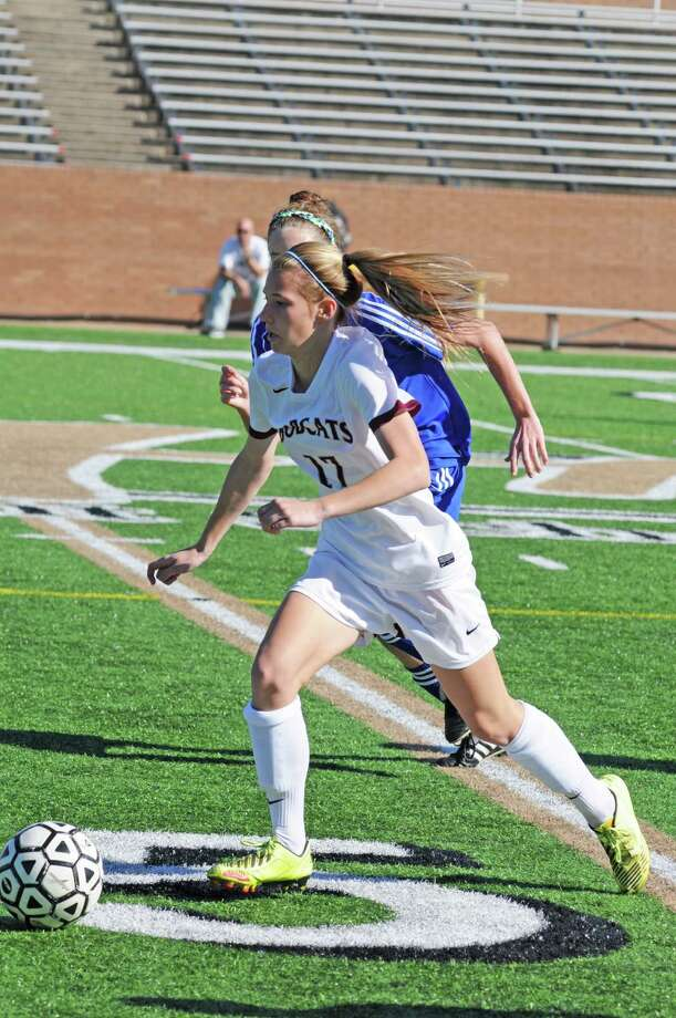 Cy-Fair sophomore midfielder Sydney Daubendiek (17) takes off. Cy-Fair girls soccer defeated Friendswood 1-0 during the Katy I-10 Shootout on 1-18-13 at Rhodes Stadium, and the victory was part of a 4-0-2 overall start in 2013 by the Lady Bobcats. Photo: L. Scott Hainline, Freelance / Freelance