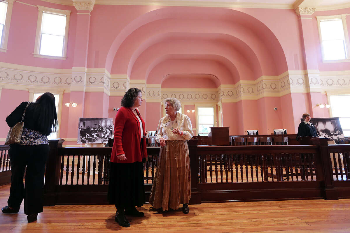 Ruby Perez, left, talks with docent Sami Devillier, (cq), during the rededication ceremony of the Comal County Courthouse, Tuesday, Jan. 22, 2013. The courthouse under went a three-year, $8.6 million restoration with funds from the Texas Historical Commission. Both ladies are with the Comal County Historical Commission.