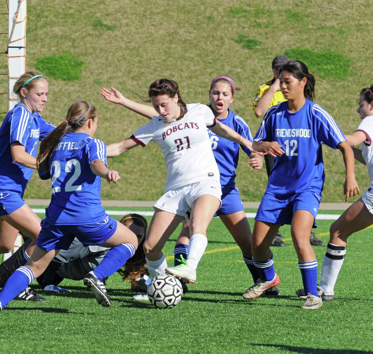 Cy-Fair junior Delaney Reynolds (21) is surrounded near the goal by Friendswood Lady Mustangs during the Bobcats' 1-0 win at the Katy I-10 Shootout earlier this month at Rhodes Stadium. The victory was part of a 4-0-2 overall start by Cy-Fair.
