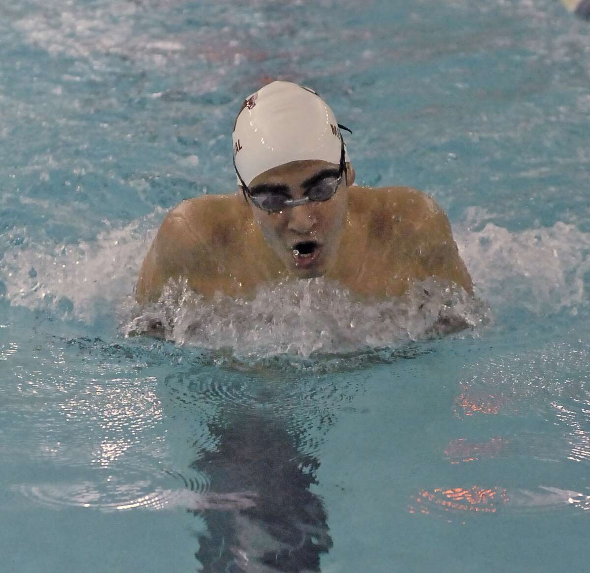 Memorial's Maroun P Koutani competes in the men's 100 yard breaststroke during their meet with Westside at the Spring Branch ISD Natatorium Thursday 1/17/13. Photo by Tony Bullard.