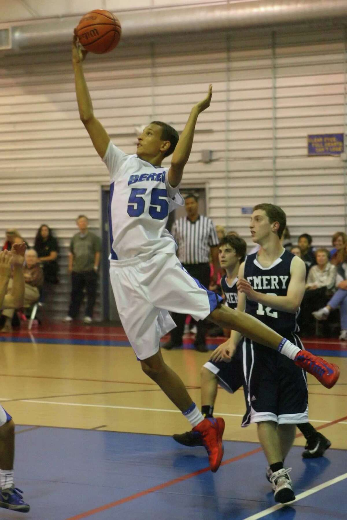 Drayton Ratcliff snags the rebound to keep the ball in play Tuesday night during the Emery game.