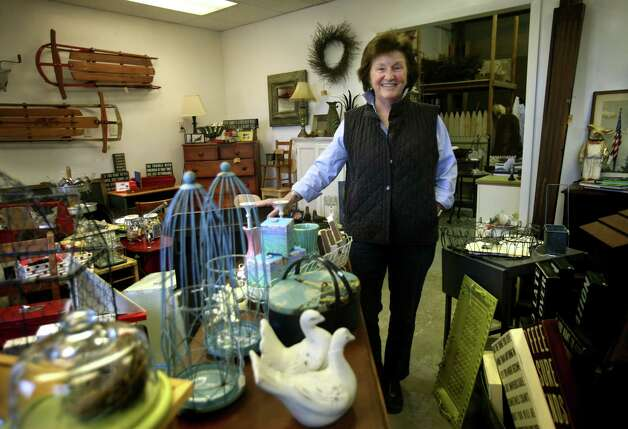 Karen Fitzgerald sells vintage-inspired items for home and garden, many of which she crafts herself, at her business, The Well Seasoned Nest, at 158 Research Drive in Milford. Photo: Brian A. Pounds / Connecticut Post