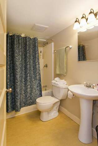 Lower-level guest quarters bathroom of 406 21st Ave. The 2,340-square-foot house, built in 1900, has four bedrooms and 3.25 bathrooms exposed-wood railings, French doors and front and back decks on a 1,495-square-foot lot. It's listed for $519,950. Photo: Courtesy Dorothy Driver/Windermere Real Estate