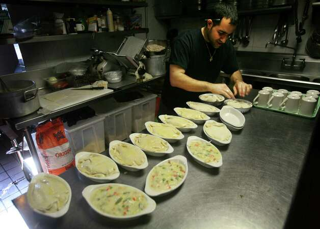 Sabatino Kikis, son-in-law of owner Gus Grigoriadis, makes pot pies at Pop's Family Restaurant in Milford on Tuesday, January 22, 2013. The restaurant's new location is under construction on Old Gate Lane in Milford. Photo: Brian A. Pounds / Connecticut Post