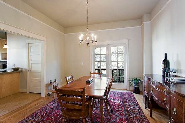 Dining room of 406 21st Ave. The 2,340-square-foot house, built in 1900, has four bedrooms and 3.25 bathrooms -- including a separate, lower-level guest quarters -- exposed-wood railings, French doors and front and back decks on a 1,495-square-foot lot. It's listed for $519,950. Photo: Courtesy Dorothy Driver/Windermere Real Estate