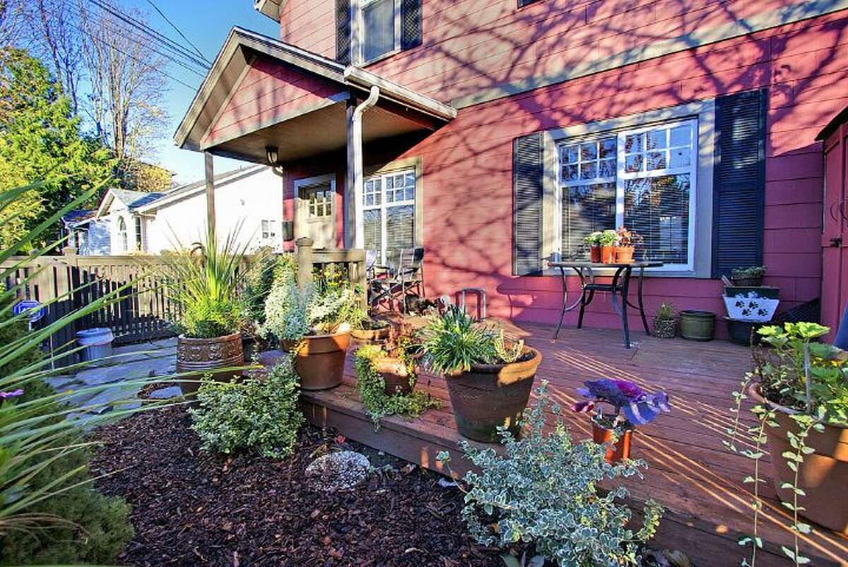 Front of 406 21st Ave. The 2,340-square-foot house, built in 1900, has four bedrooms and 3.25 bathrooms -- including a separate, lower-level guest quarters -- exposed-wood railings, French doors and front and back decks on a 1,495-square-foot lot. It's listed for $519,950.