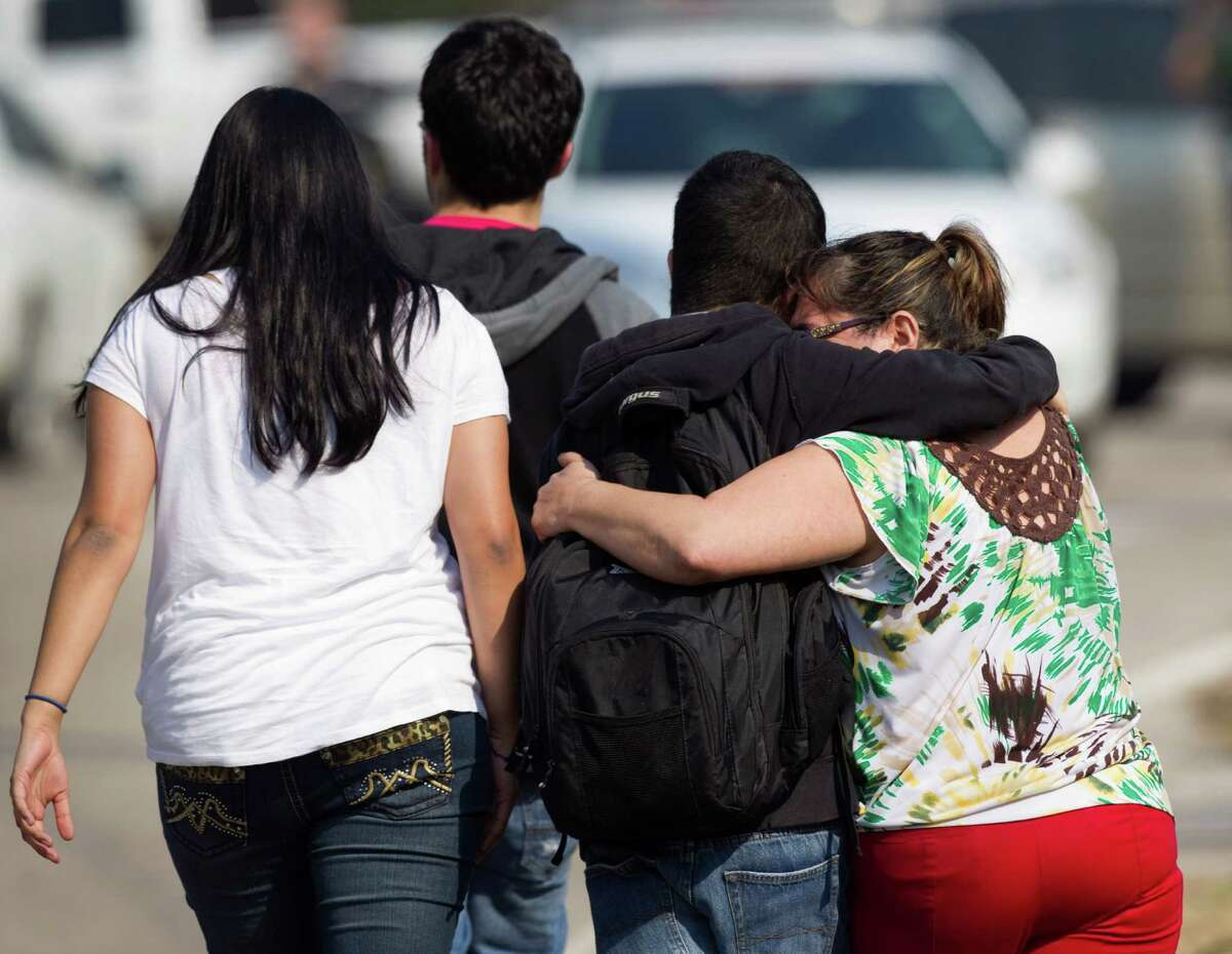 A woman embraces a Lone Star College student after he was evacuated from the campus following a shooting at the north Harris County school Tuesday, Jan. 22, 2013, in Houston. ( Brett Coomer / Houston Chronicle )