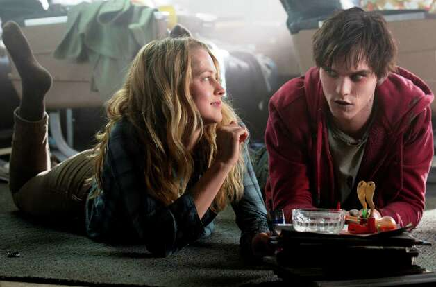 "Teresa Palmer and Nicholas Hoult star in the  zombie love story ""Warm Bodies."" Photo: Summit Entertainment"