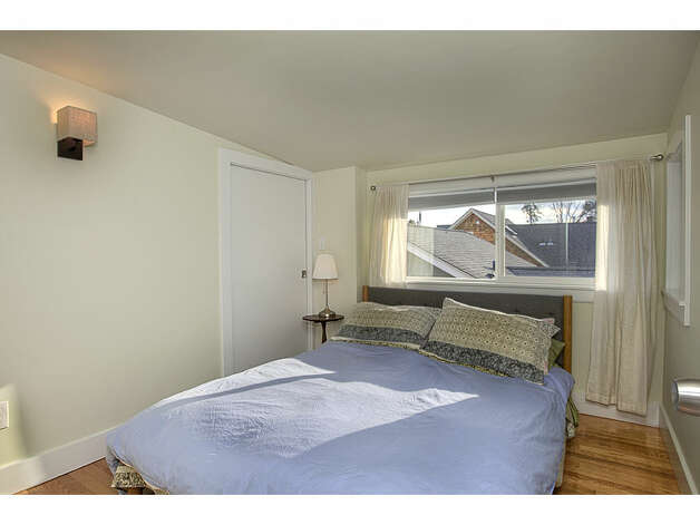 Bedroom of 337 26th Ave. The 2,580-square-foot house, built in 1914, has four bedrooms, 1.75 bathrooms, exposed wood moldings, a skylight, a family room, a front porch, a back deck and a patio on a 4,400-square-foot lot. It's listed for $520,000. Photo: Gregory White, Courtesy Diane Lancaster/Windermere Real Estate / (C) 2012 Gregory White