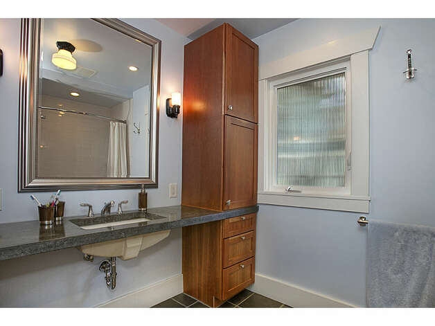 Bathroom of 337 26th Ave. The 2,580-square-foot house, built in 1914, has four bedrooms, 1.75 bathrooms, exposed wood moldings, a skylight, a family room, a front porch, a back deck and a patio on a 4,400-square-foot lot. It's listed for $520,000. Photo: Gregory White, Courtesy Diane Lancaster/Windermere Real Estate / (C) 2012 Gregory White