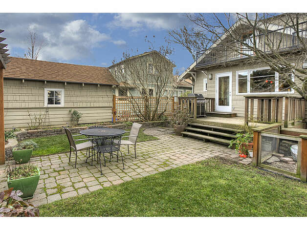 Backyard of 337 26th Ave. The 2,580-square-foot house, built in 1914, has four bedrooms, 1.75 bathrooms, exposed wood moldings, a skylight, a family room, a front porch, a back deck and a patio on a 4,400-square-foot lot. It's listed for $520,000. Photo: Gregory White, Courtesy Diane Lancaster/Windermere Real Estate / (C) 2012 Gregory White